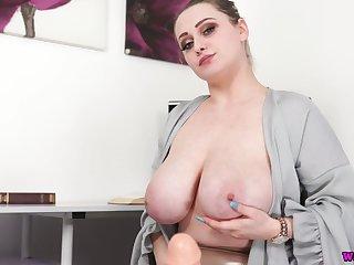 Super horny bosomy Rachael C shows off her cock stroking skills