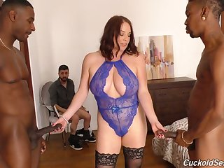 Versatile voluptuous white cowgirl Maggie Green works on two fat BBCs at once