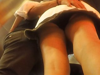 Upskirt of a MILF with hubby