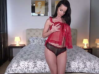 Jaw dropping brunet milf Cindy Dollar shows off her big fake tits