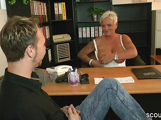 Short haired german MILF seduces guy in the office