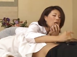 Japanese mature MILF giving head