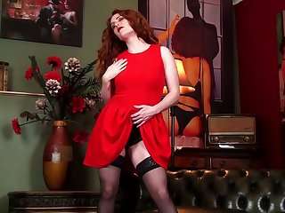 Red haired milf Amy C is finger fucking her nasty and insatiable cunt