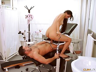 Slim beauty sits on the doctor's dick for a nice pussy ride