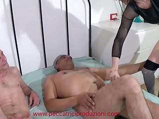 Slim mature whore has fun with two cocky freaks