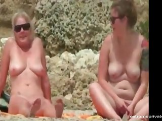 During our holiday my wife and my busty friend us by going naked on the beach.