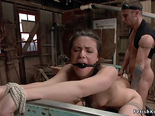 Savage hunter ties up and bangs two slaves