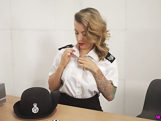 Horny British cop Charlie Z is ready to pet her own shaved pussy