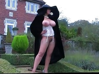 busty madam enjoys in showing her naked and big tits to the camera