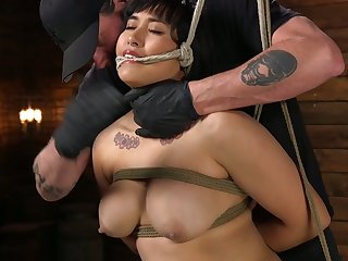 Tied up chubby model Mia Little gets her pussy punished in the dark basement